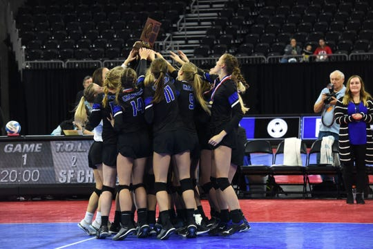 Sioux Falls Christian team celebrates after winning the class A state championship, Saturday, Nov. 17, 2018, at the Denny Sanford Premier Center in Sioux Falls, S.D.