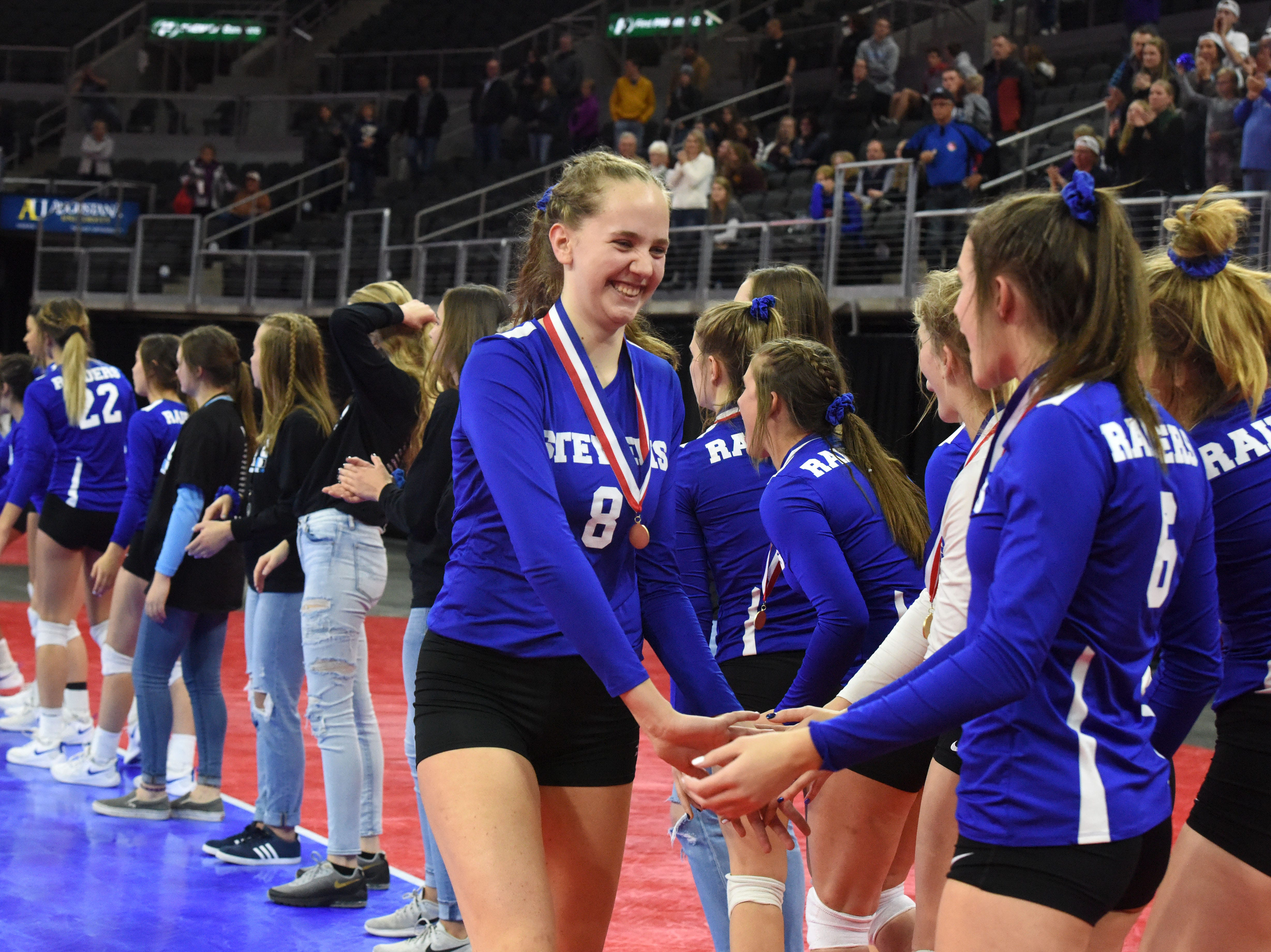 Rapid City's Phebie Rossi (8) celebrates with her teammates after they won the class AA state championship, Saturday, Nov. 17, 2018, at the Denny Sanford Premier Center in Sioux Falls, S.D.