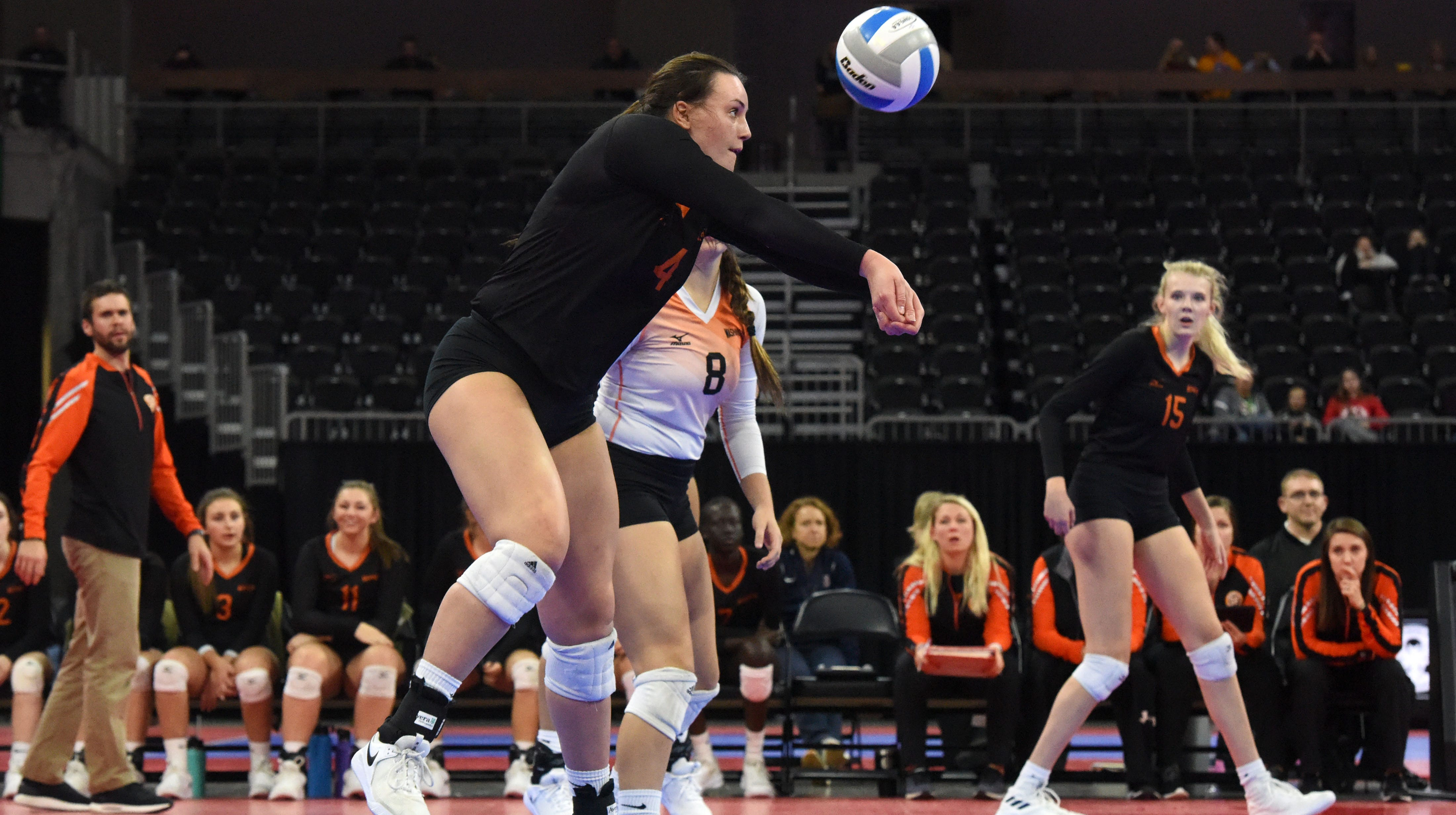 Washington's Lily Bartling (4) bumps the ball during a match against Rapid City, Saturday, Nov. 17, 2018, at the Denny Sanford Premier Center in Sioux Falls, S.D.