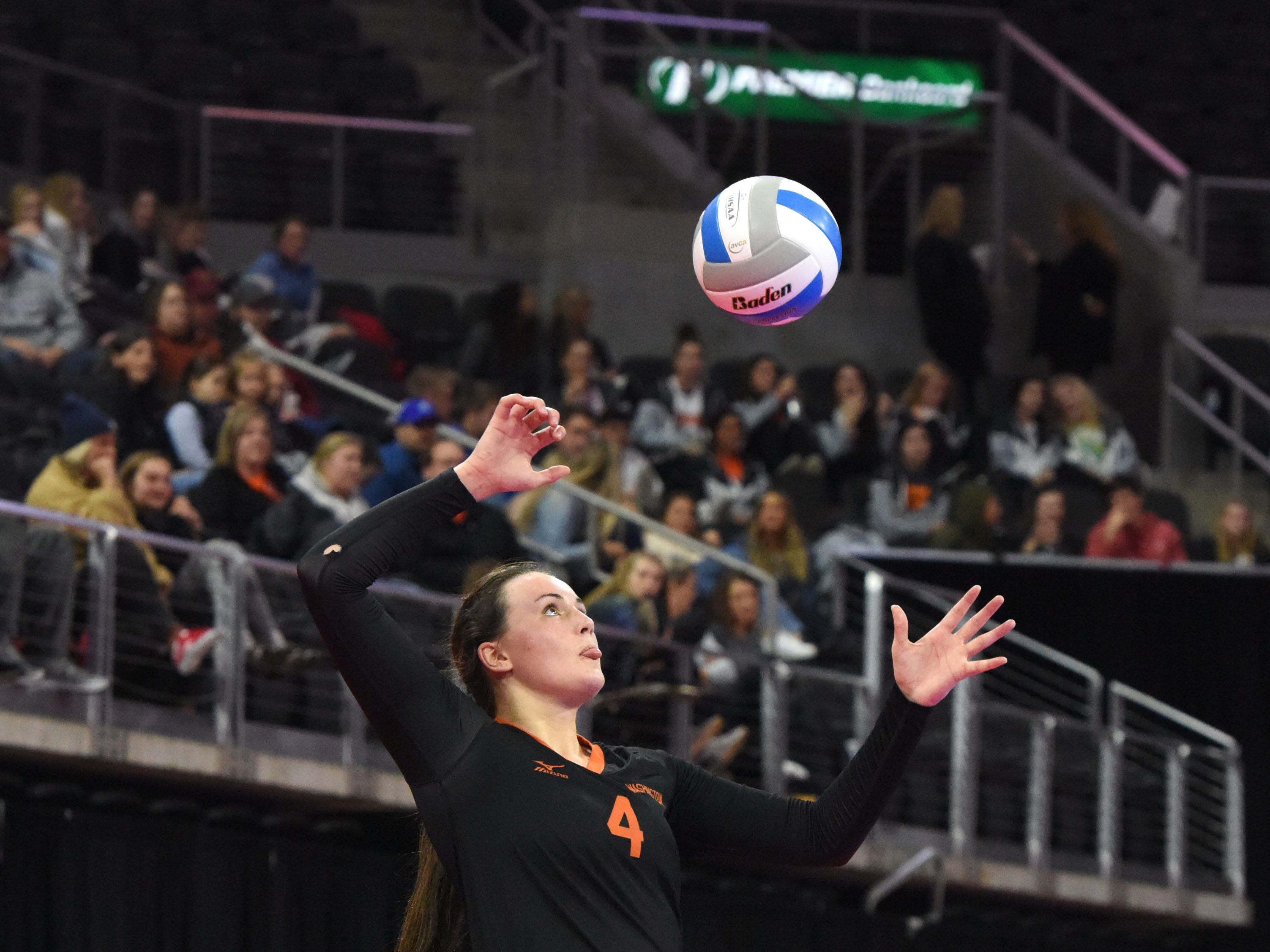 Washington's Lily Bartling (4) serves the ball during a match against Rapid City, Saturday, Nov. 17, 2018, at the Denny Sanford Premier Center in Sioux Falls, S.D.