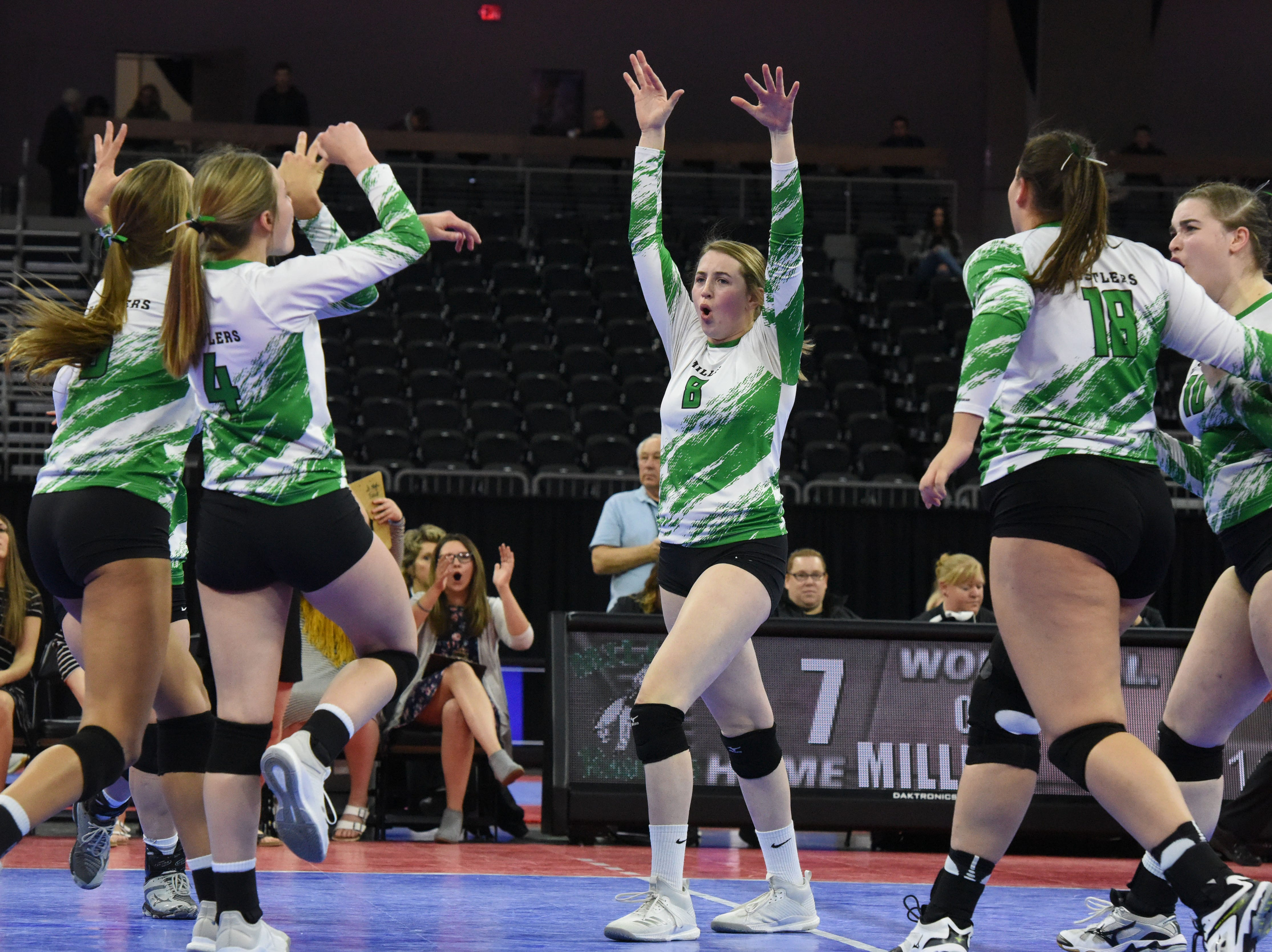 Miller players react during a match against Sioux Falls Christian, Saturday, Nov. 17, 2018, at the Denny Sanford Premier Center in Sioux Falls, S.D.