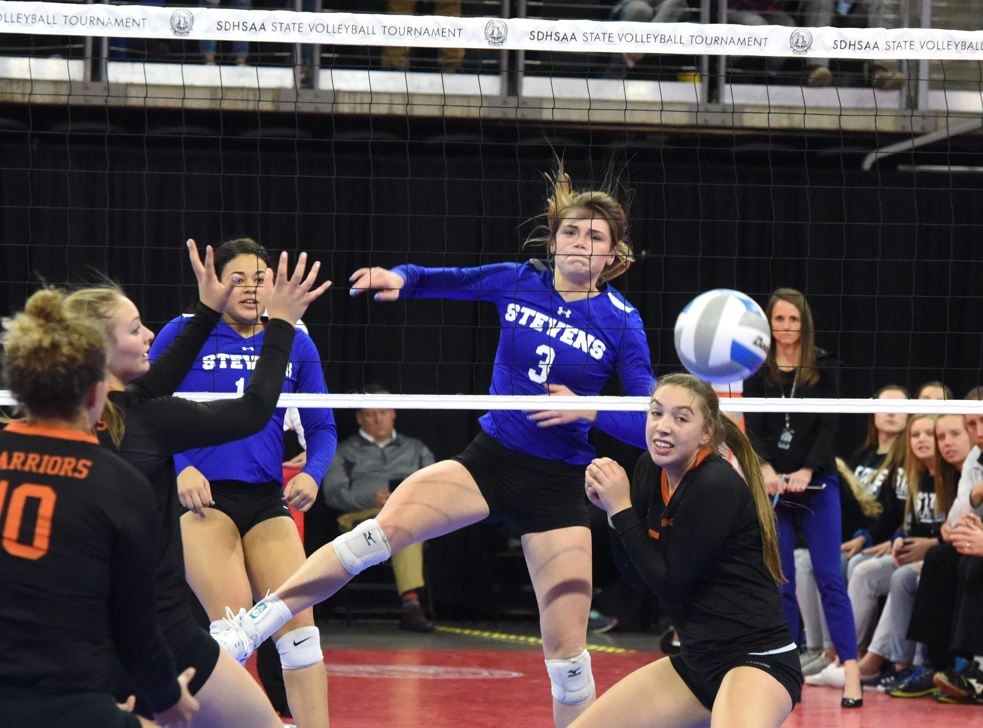 Rapid City's Elizabeth Schaefer (3) spikes the ball during a match against Washington, Saturday, Nov. 17, 2018, at the Denny Sanford Premier Center in Sioux Falls, S.D.