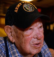 Vince Plaster ,a WW ll veteran, was honored for his 100th birthday at VFW Post 3404's annual Thanksgiving dinner Sunday, Nov. 18, 2018.