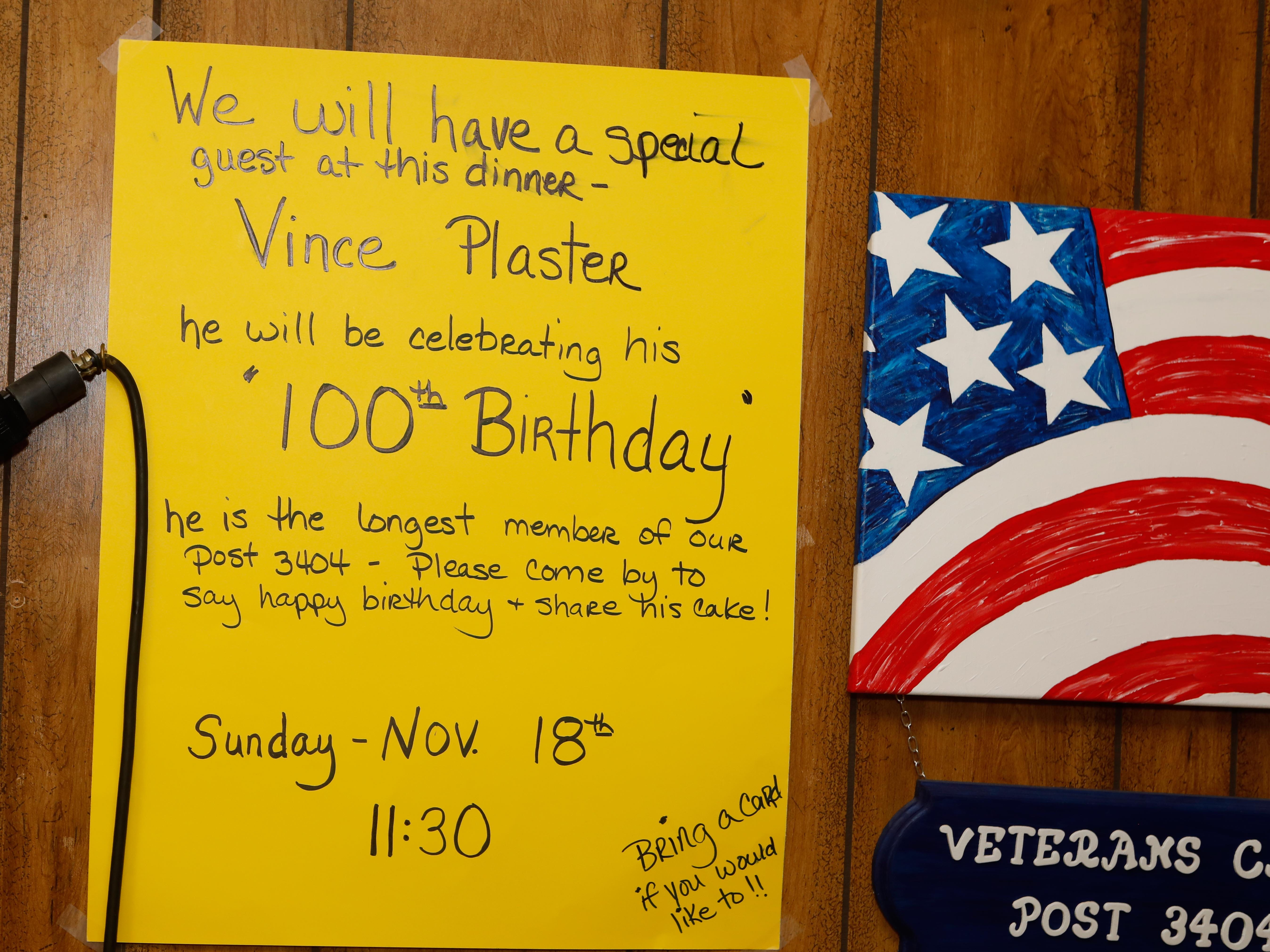 Vince Plaster, a WW ll veteran, was honored for his 100th birthday at VFW Post 3404's annual Thanksgiving dinner. A sign say he is the post's longest-serving member.