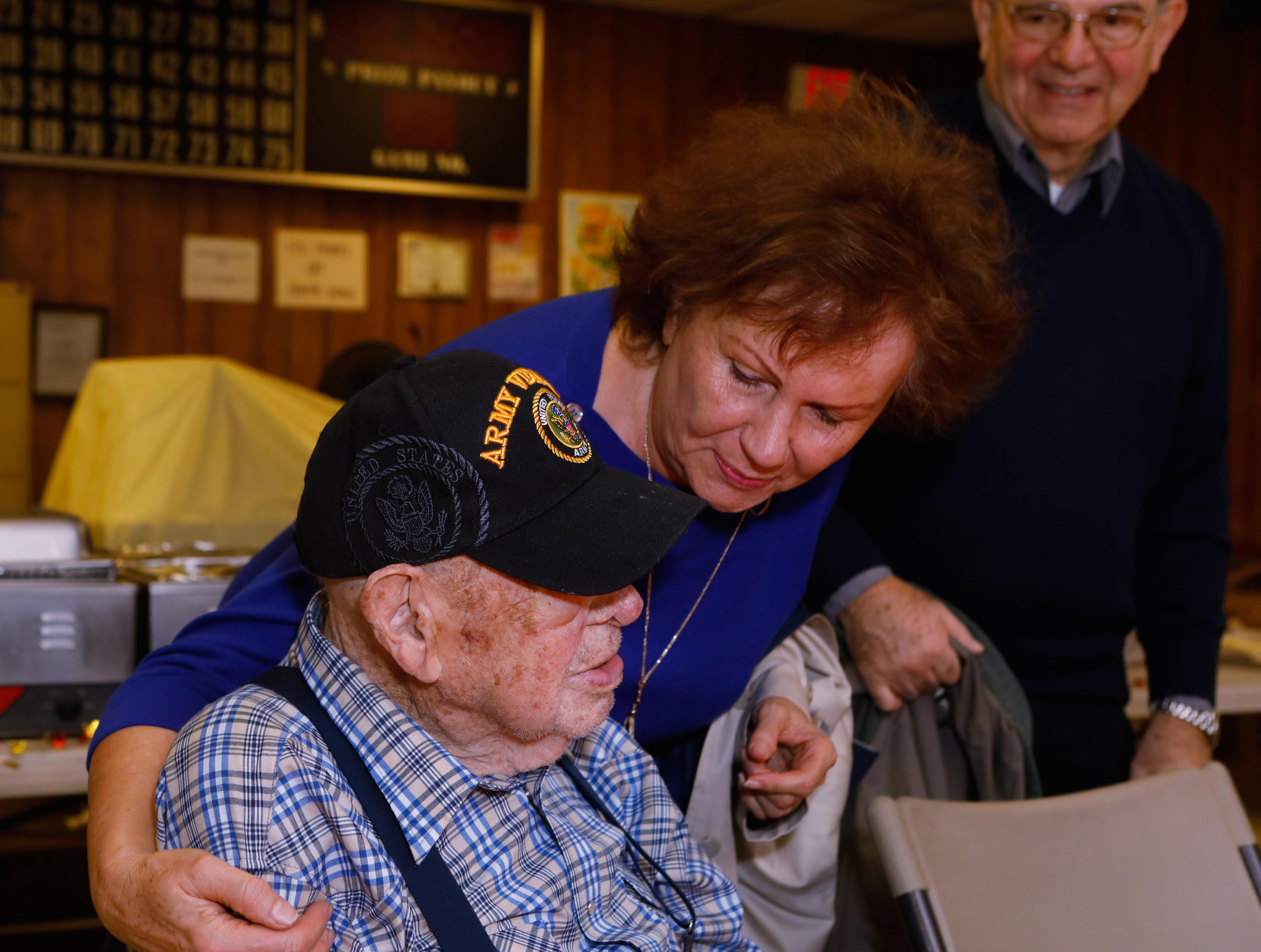 Christine Vergara, gives her neighbor Vince Plaster a hug Sunday, Nov. 18, 2018 at VFW Post 3404's annual Thanksgiving dinner, where Plaster was the guest of honor for his 100th birthday.