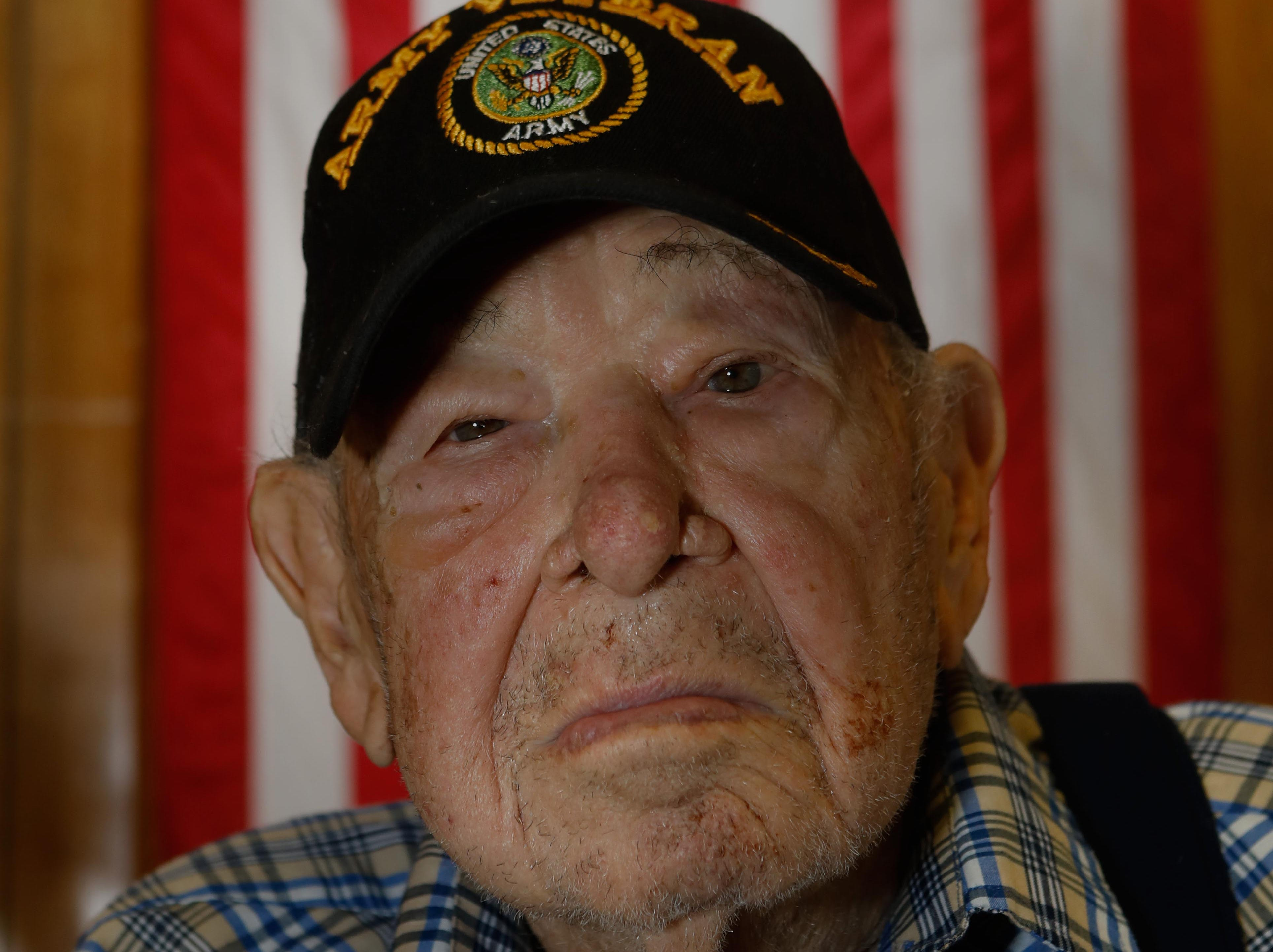 Vince Plaster, a WW ll veteran, was honored for his 100th birthday at VFW Post 3404's annual Thanksgiving dinner Sunday, Nov. 18, 2018.
