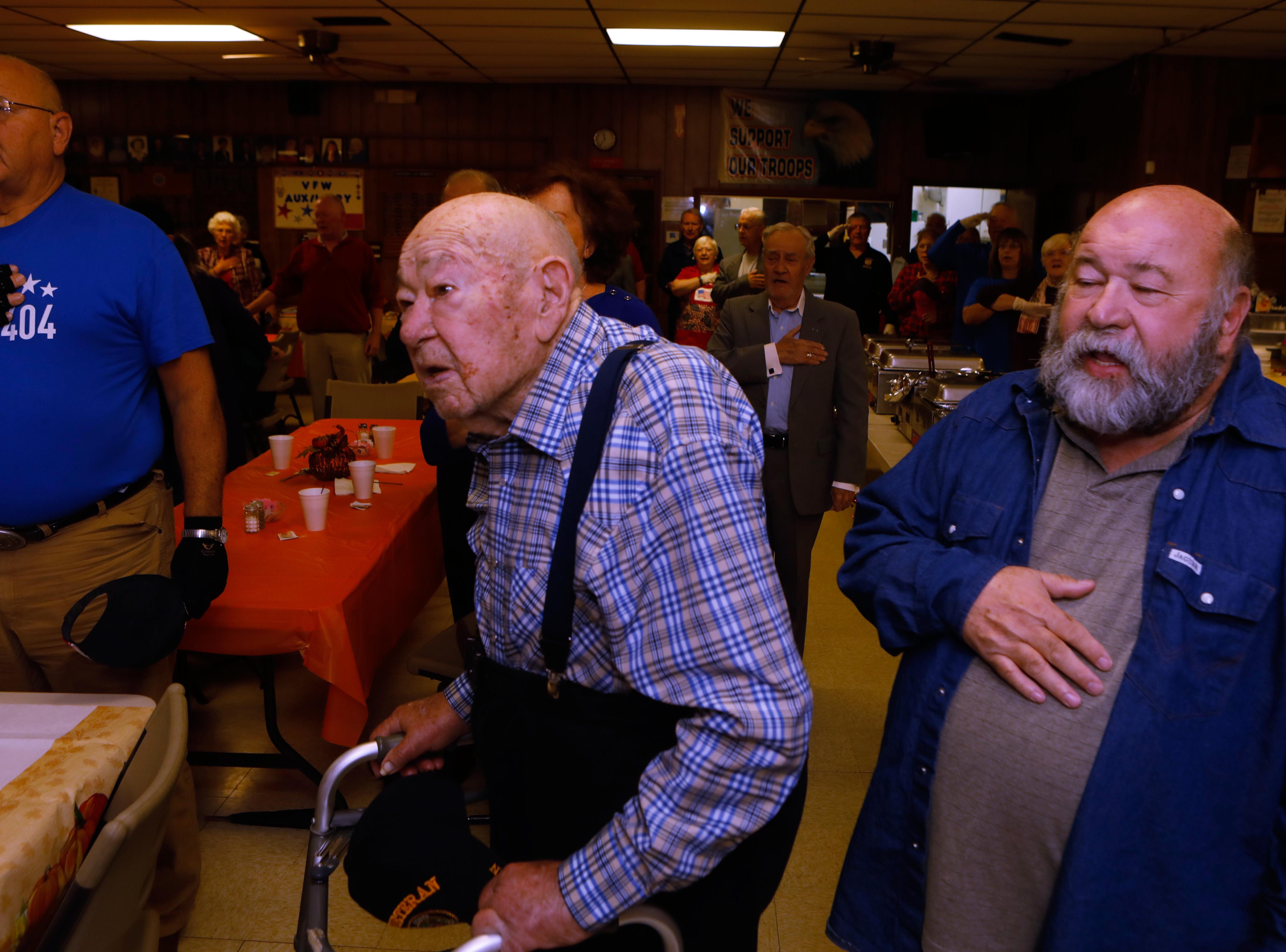 Vincent Plaster, left, and son Edward Plaster say the Pledge of Allegiance at VFW Post 3404's annual Thanksgiving dinner Sunday, Nov. 18, 2018, where Vince Plaster was the special guest in honor of his 100th birthday,