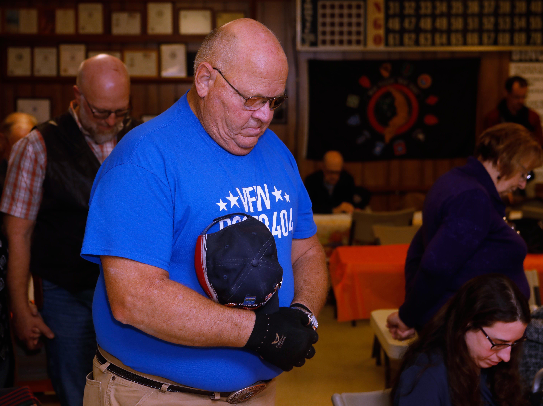 John Roush prays at VFW Post 3404's annual Thanksgiving dinner Sunday, Nov. 18, 2018.