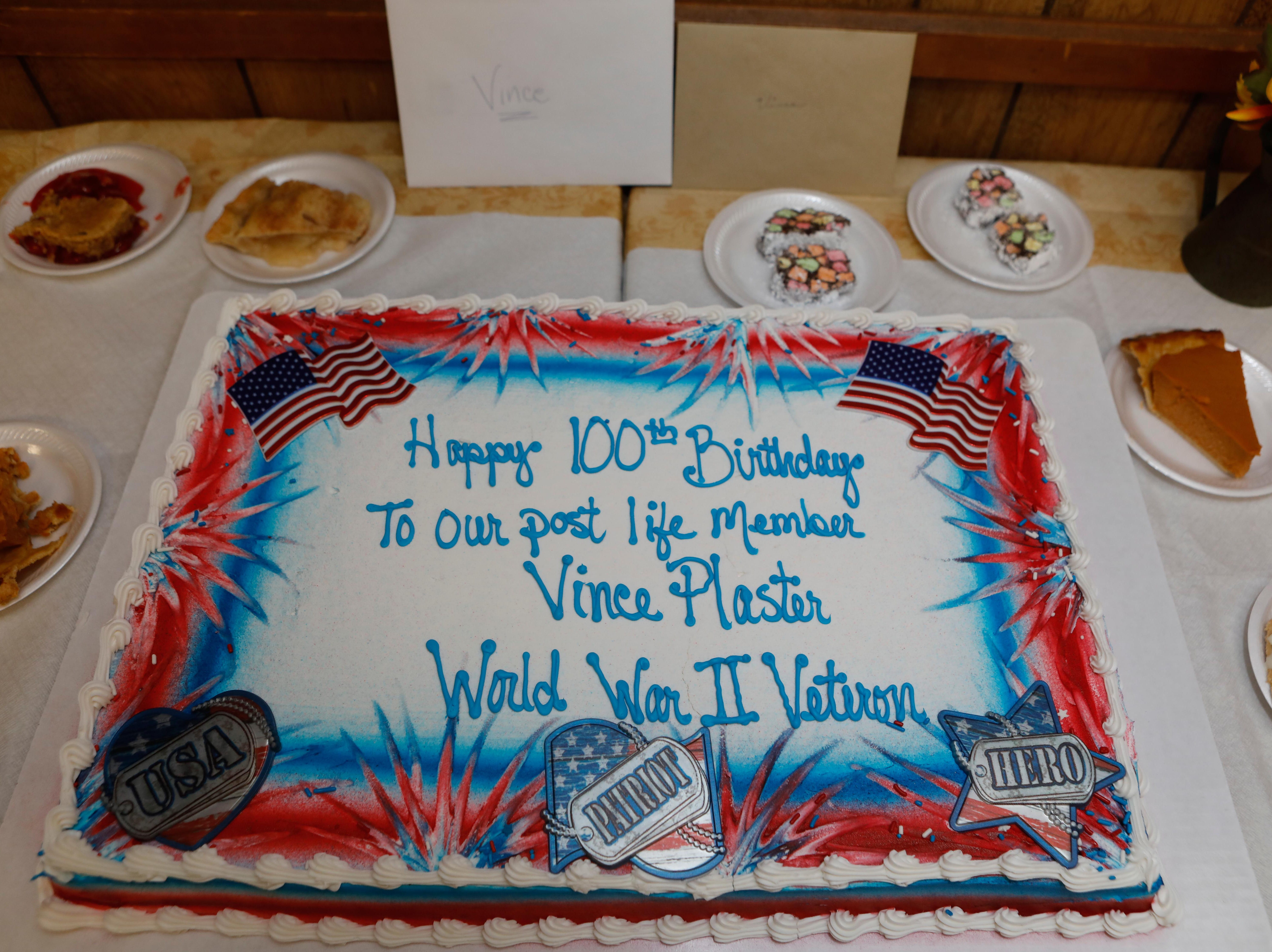 Vince Plaster, a WW ll veteran, was honored for his 100th birthday at VFW Post 3404's annual Thanksgiving dinner on Sunday, Nov. 18, 2018.