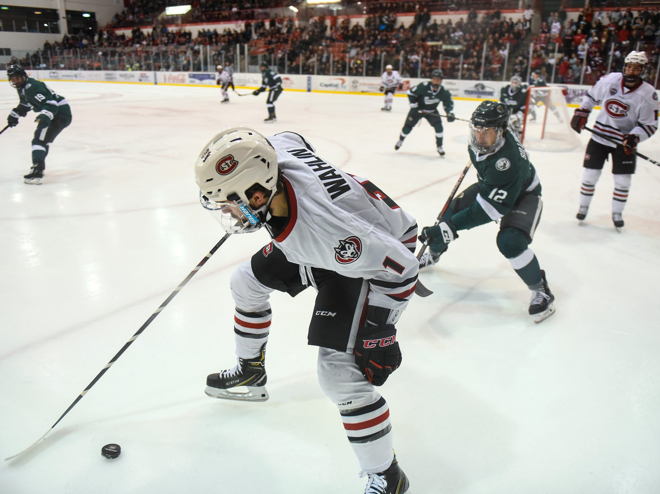 St. Cloud State's Jake Wahlin works with the puck along the boards during the first period of the Saturday, Nov. 17, game against Bemidji State at the Herb Brooks National Hockey Center in St. Cloud.