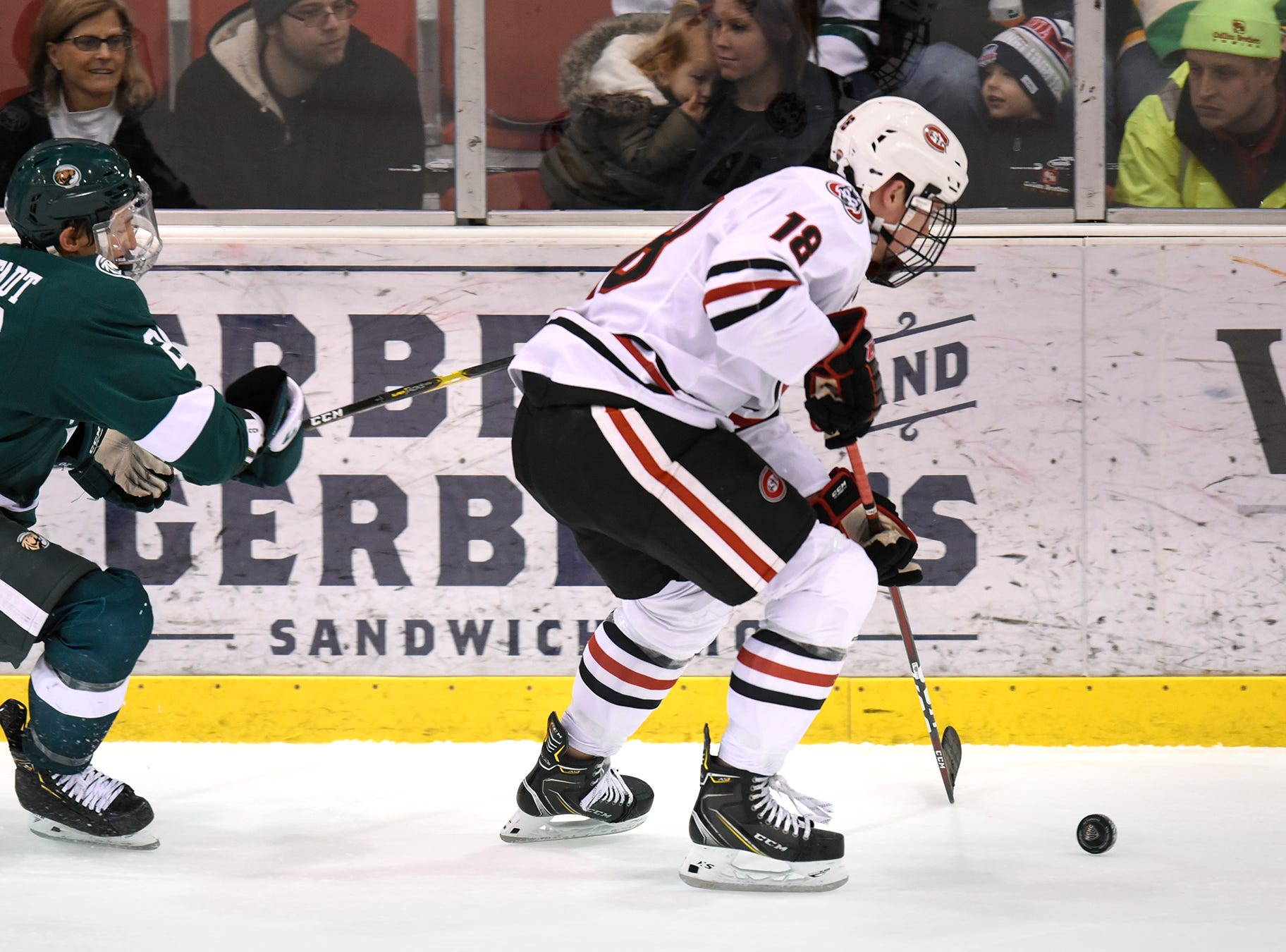 St. Cloud State's Brendan Bushy skates with the puck during the first period of the Saturday, Nov. 17, game against Bemidji State at the Herb Brooks National Hockey Center in St. Cloud.