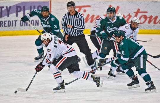 St. Cloud State's Nick Poehling advances with the puck during the first period of the Saturday, Nov. 17, game against Bemidji State at the Herb Brooks National Hockey Center in St. Cloud.