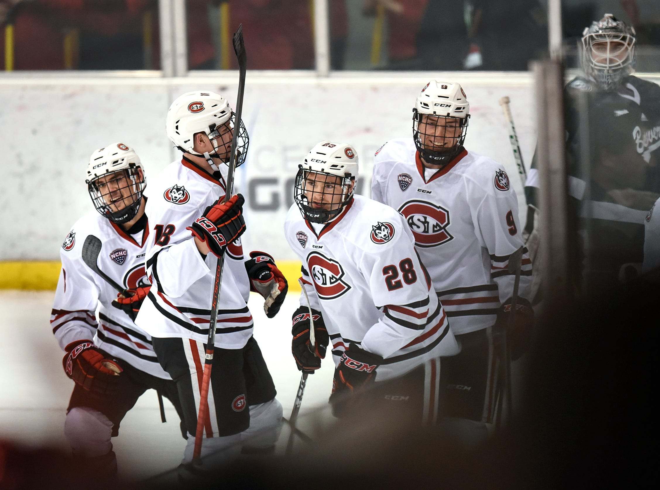 St. Cloud State players celebrate a goal by Kevin Fitzgerald during the first period of the Saturday, Nov. 17, game against Bemidji State at the Herb Brooks National Hockey Center in St. Cloud.