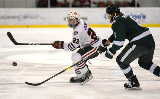 Robby Jackson skates with the puck during the first period of the Saturday, Nov. 17, game against Bemidji State at the Herb Brooks National Hockey Center in St. Cloud.