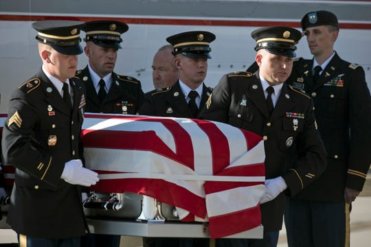 Utah National Guard Honor Guard carry a casket containing the remains of Maj. Brent R. Taylor at the National Guard base in Salt Lake City on Wednesday, Nov. 14, 2018. His funeral was Saturday the 20th.