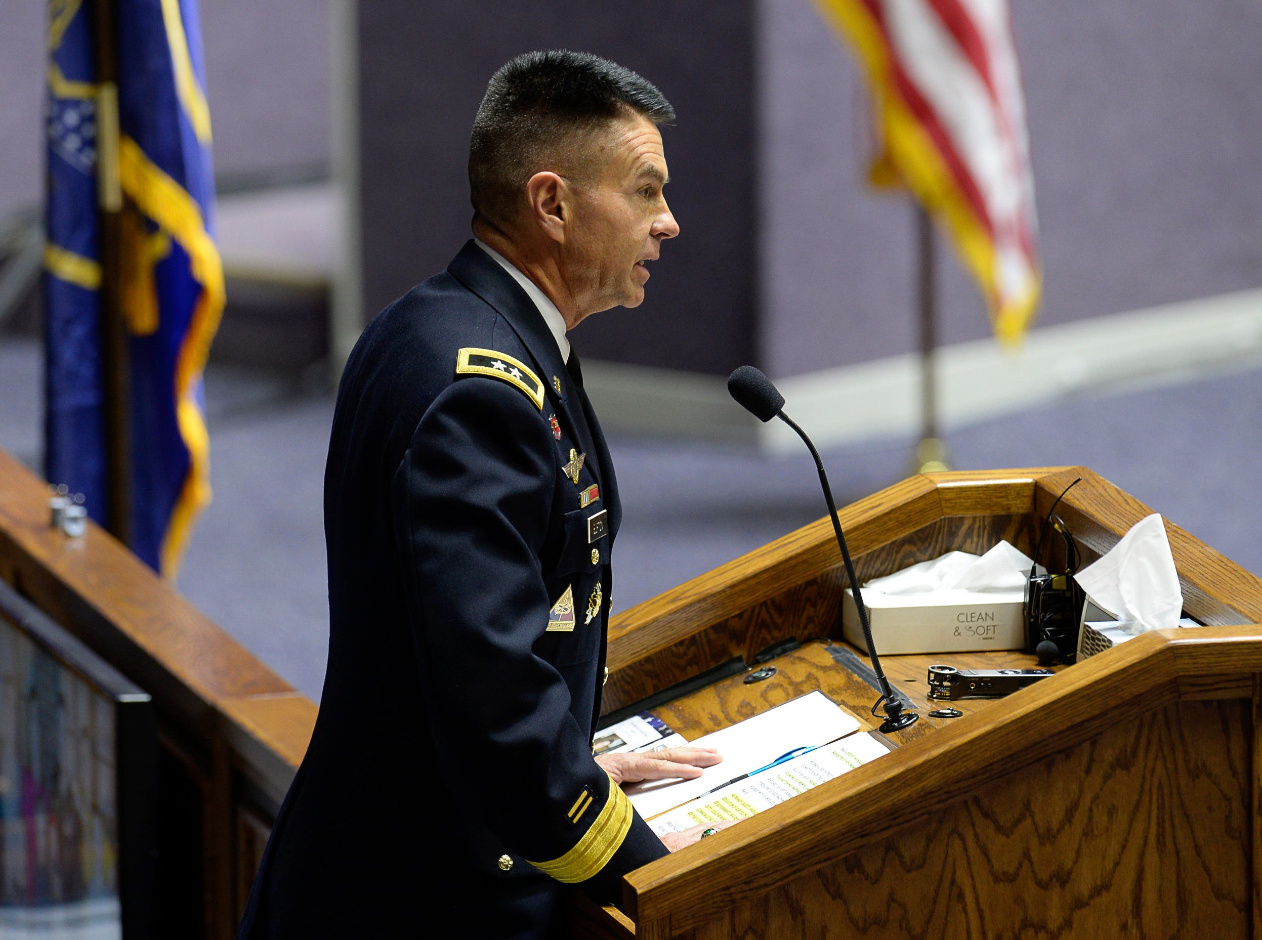 Utah Army National Guard Maj. Gen. Jefferson Burton speaks about service during Maj. Brent R. Taylor's funeral services at Weber State University's Dee Event Center in Ogden, Utah on Saturday, Nov. 17, 2018.