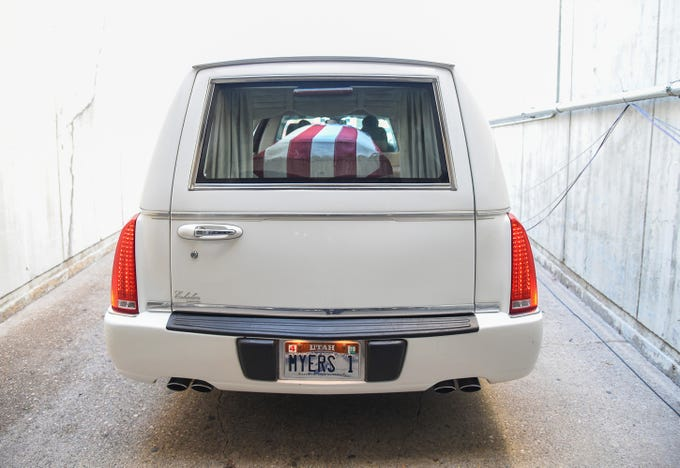 A hearse containing Maj. Brent R. Taylor leaves Weber State University's Dee Event Center in Ogden, Utah on Saturday, Nov. 17, 2018, following funeral services.
