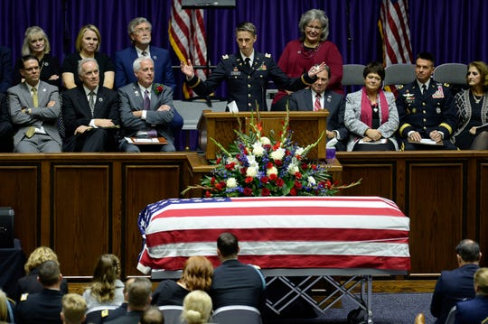 Captain Derek Taylor, brother of Maj. Brent R. Taylor, speaks about his brother during funeral services at Weber State University's Dee Event Center in Ogden, Utah on Saturday, Nov. 17, 2018. Taylor, 39, the mayor of North Ogden, died Nov. 3, 2018, while serving in Afghanistan.