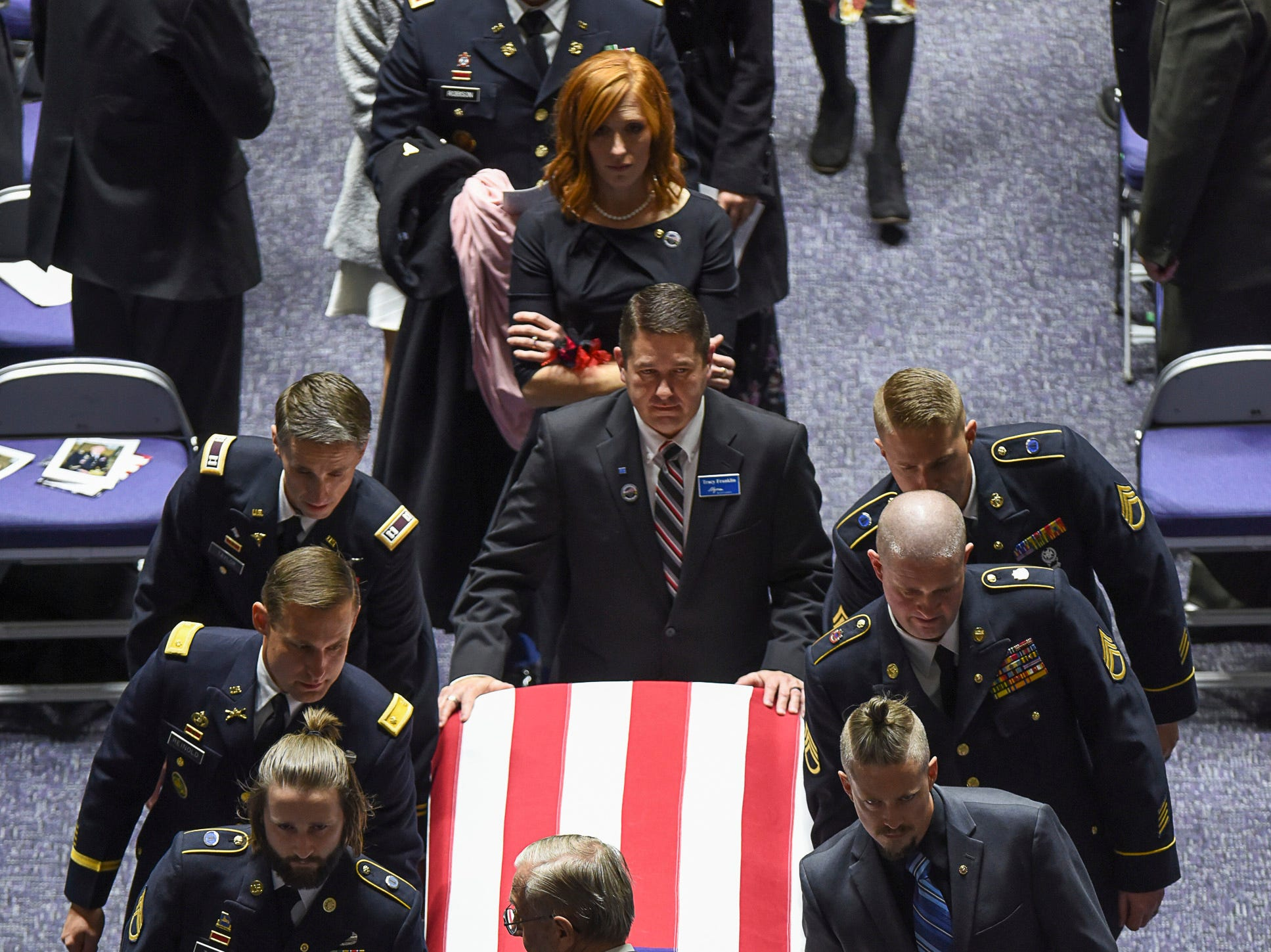 Jennie Taylor follows the casket holding her husband, Maj. Brent R. Taylor' during services at Weber State University's Dee Event Center in Ogden, Utah on Saturday, Nov. 17, 2018. Taylor, 39, the mayor of North Ogden, died Nov. 3, 2018, while serving in Afghanistan.