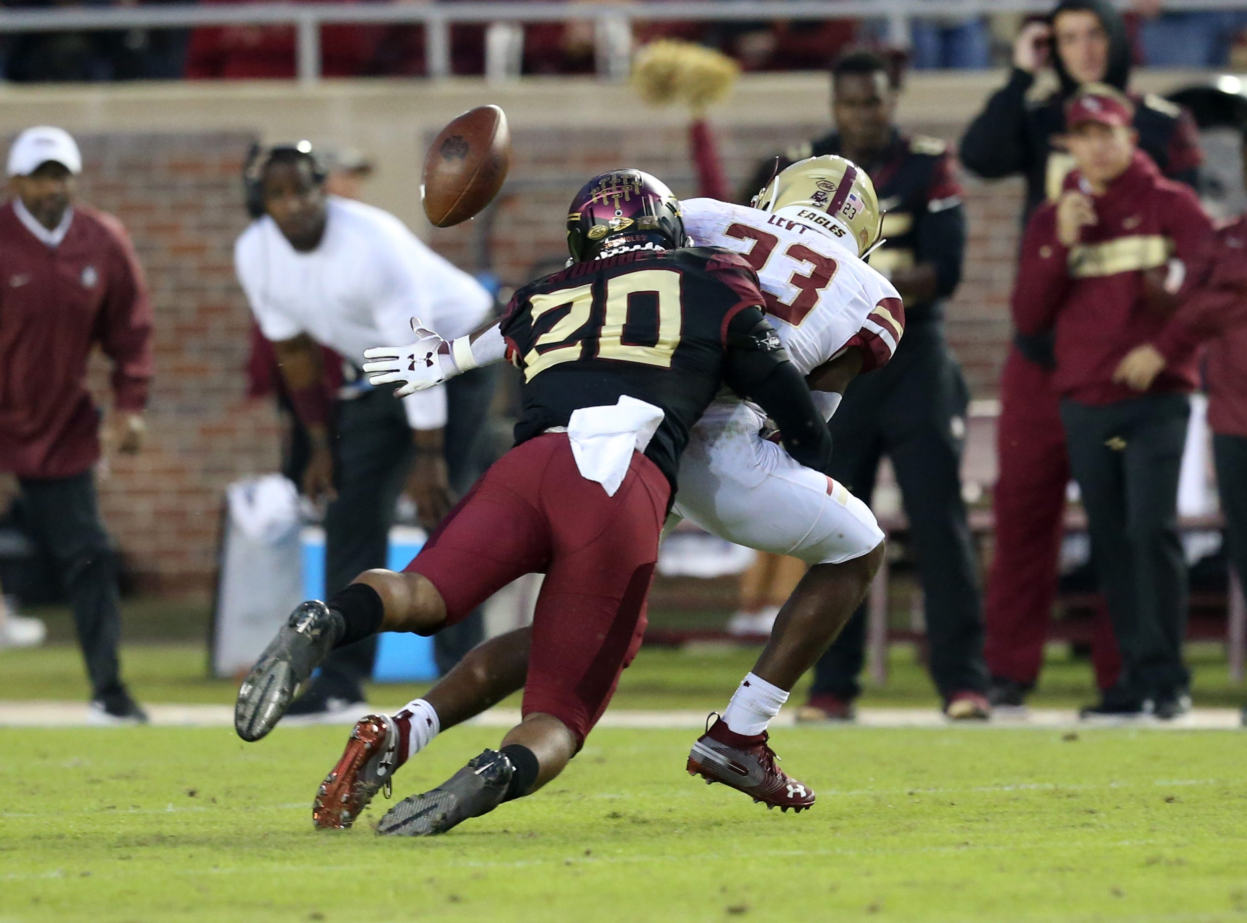 Florida State Seminoles defensive back Jaiden Woodbey (20) tackles Boston College Eagles linebacker Curt Bletzer (33) as the Florida State Seminoles face off against the Boston College Eagles at Doak S. Campbell Stadium, Saturday, Nov. 17, 2018.