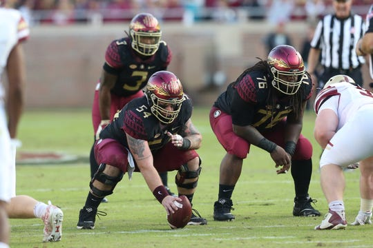 Florida State Seminoles offensive lineman Alec Eberle (54) ready for next down as the Florida State Seminoles face off against the Boston College Eagles at Doak S. Campbell Stadium, Saturday, Nov. 17, 2018.