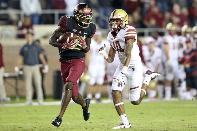 Florida State Seminoles wide receiver Tamorrion Terry (15) runs in the game winning touchdown as the Florida State Seminoles face off against the Boston College Eagles at Doak S. Campbell Stadium, Saturday, Nov. 17, 2018.