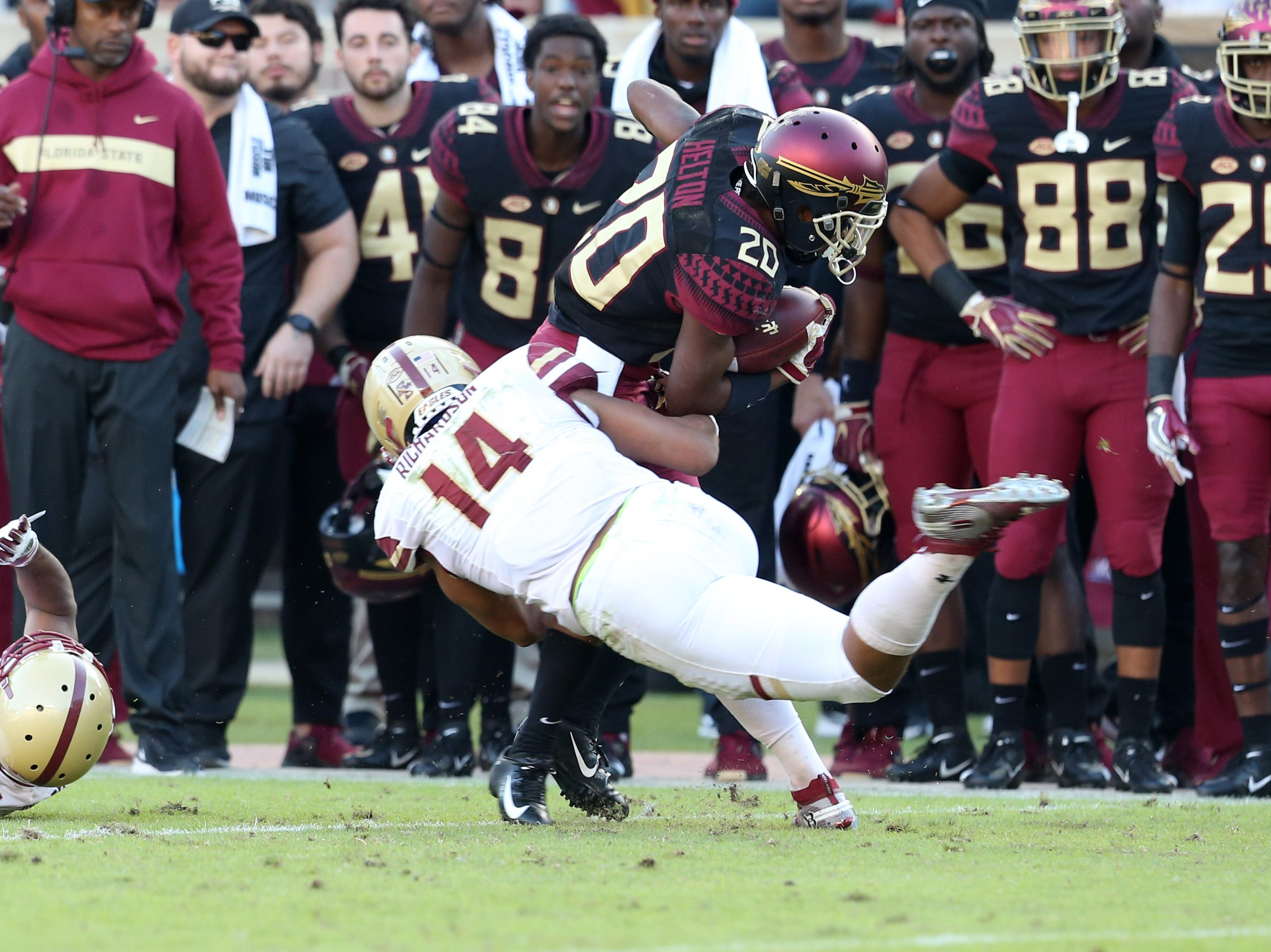 Florida State Seminoles wide receiver Keyshawn Helton (20) gets tackled by Boston College Eagles linebacker Max Richardson (14) as the Florida State Seminoles face off against the Boston College Eagles at Doak S. Campbell Stadium, Saturday, Nov. 17, 2018.