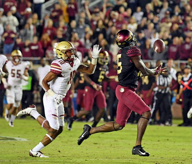 Florida State Seminoles wide receiver Tamorrion Terry (15) catches the winning touchdown past Boston College Eagles defensive back Brandon Sebastian (10) during the second half at Doak Campbell Stadium.
