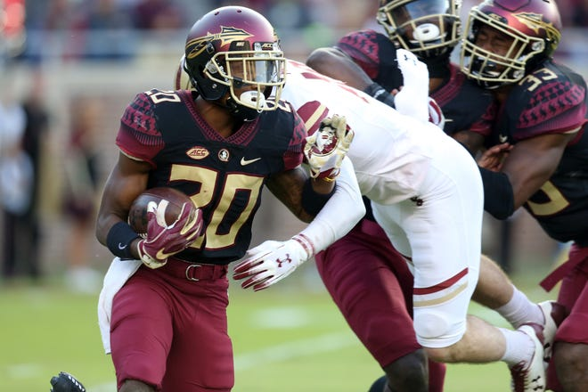 Florida State Seminoles wide receiver Keyshawn Helton (20) shakes off the defense as the Florida State Seminoles face off against the Boston College Eagles at Doak S. Campbell Stadium, Saturday, Nov. 17, 2018.