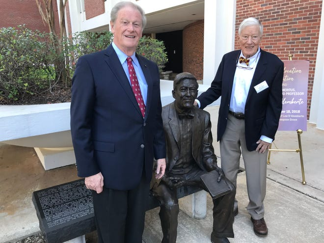 FSU President John Thrasher, left, and former FSU President and College of Law Dean Sandy D'Alemberte pose with D'Alemberte Statue at its new home at the College of Law on Sunday, Nov. 18, 2018.