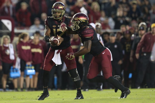 Florida State Seminoles quarterback Deondre Francois (12)  hands the ball off to Florida State Seminoles running back Cam Akers (3) as the Florida State Seminoles face off against the Boston College Eagles at Doak S. Campbell Stadium, Saturday, Nov. 17, 2018.