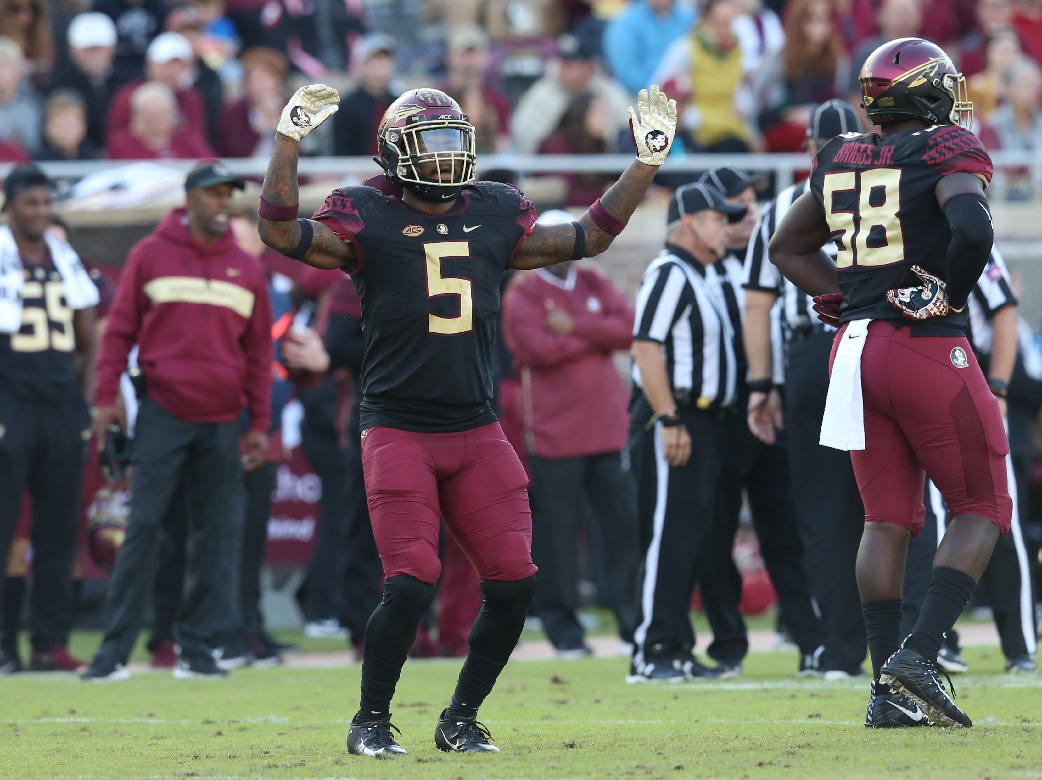 Florida State Seminoles linebacker Dontavious Jackson (5) pumps up the crowd as the Florida State Seminoles face off against the Boston College Eagles at Doak S. Campbell Stadium, Saturday, Nov. 17, 2018.