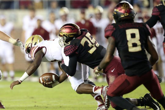 Florida State Seminoles linebacker Leonard Warner III (35) tackles the offense as the Florida State Seminoles face off against the Boston College Eagles at Doak S. Campbell Stadium, Saturday, Nov. 17, 2018.