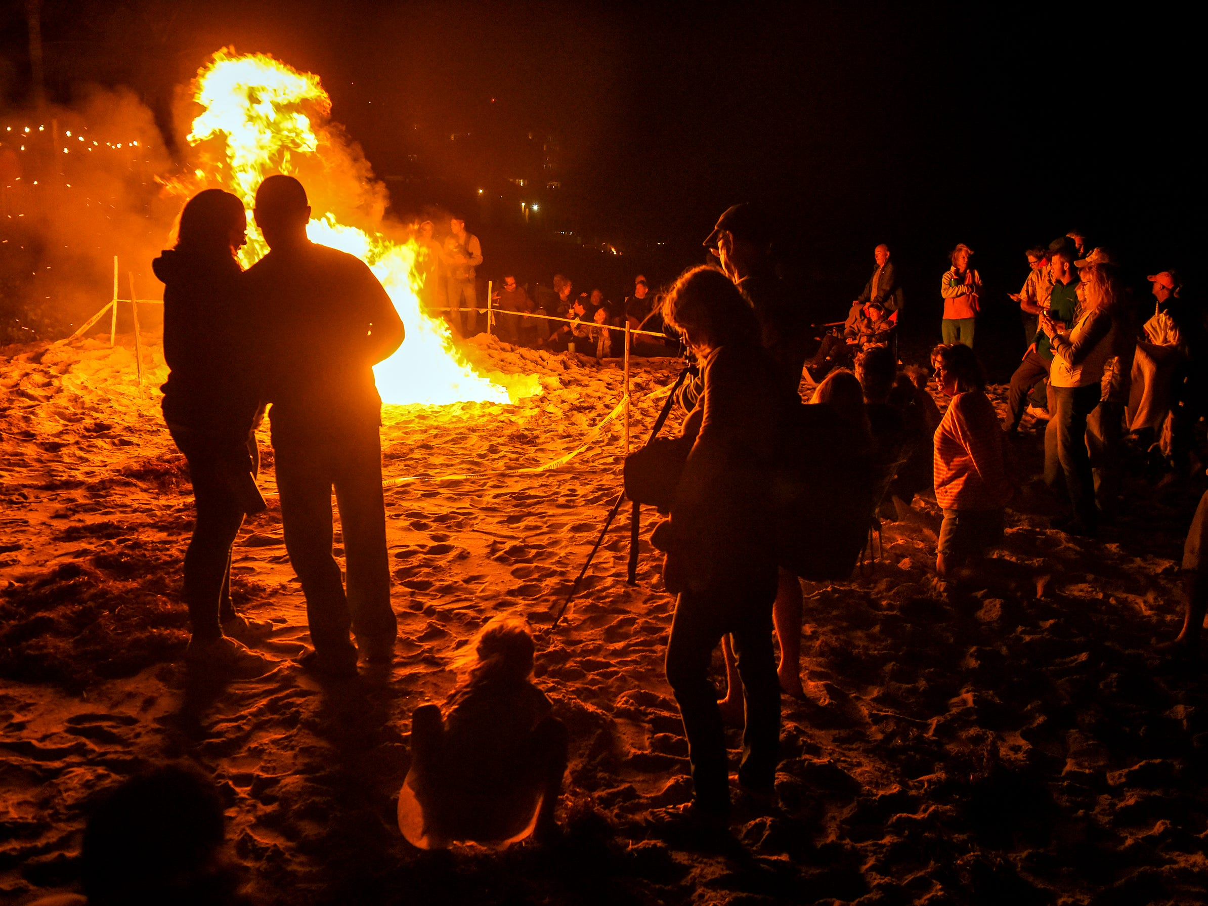 Flames light up the night Saturday, Nov. 17, 2018, during the Beachside Bonfire Fest along Sexton Plaza Beach in Vero Beach. The event, a part of Vero Beach's Centennial Celebration, featured four different themed bonfires along the beach with food, drinks, and live music.