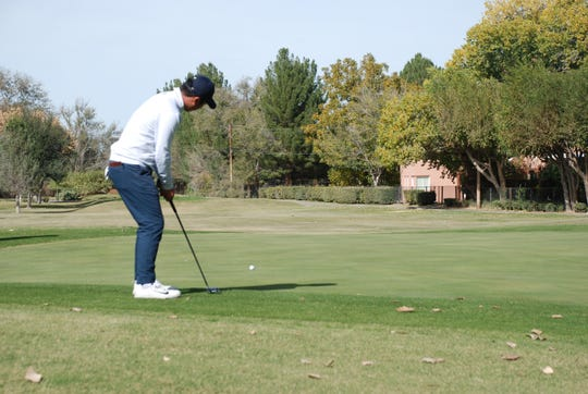 Doug Ghim of the University of Texas rolls in a put at last year's Sun Bowl tournament.