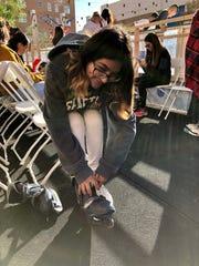 Andrea Grado of El Paso tries on ice skates for the first time Sunday at WinterFest 2018.