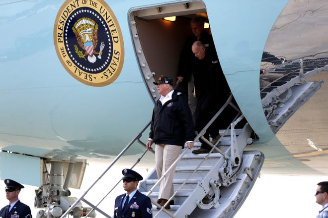 President Donald Trump arrives at Naval Base Ventura County Point Mugu on Saturday to visit areas impacted by the Woolsey Fire and meet with families of those killed in the shooting at the Borderline Bar & Grill in Thousand Oaks.