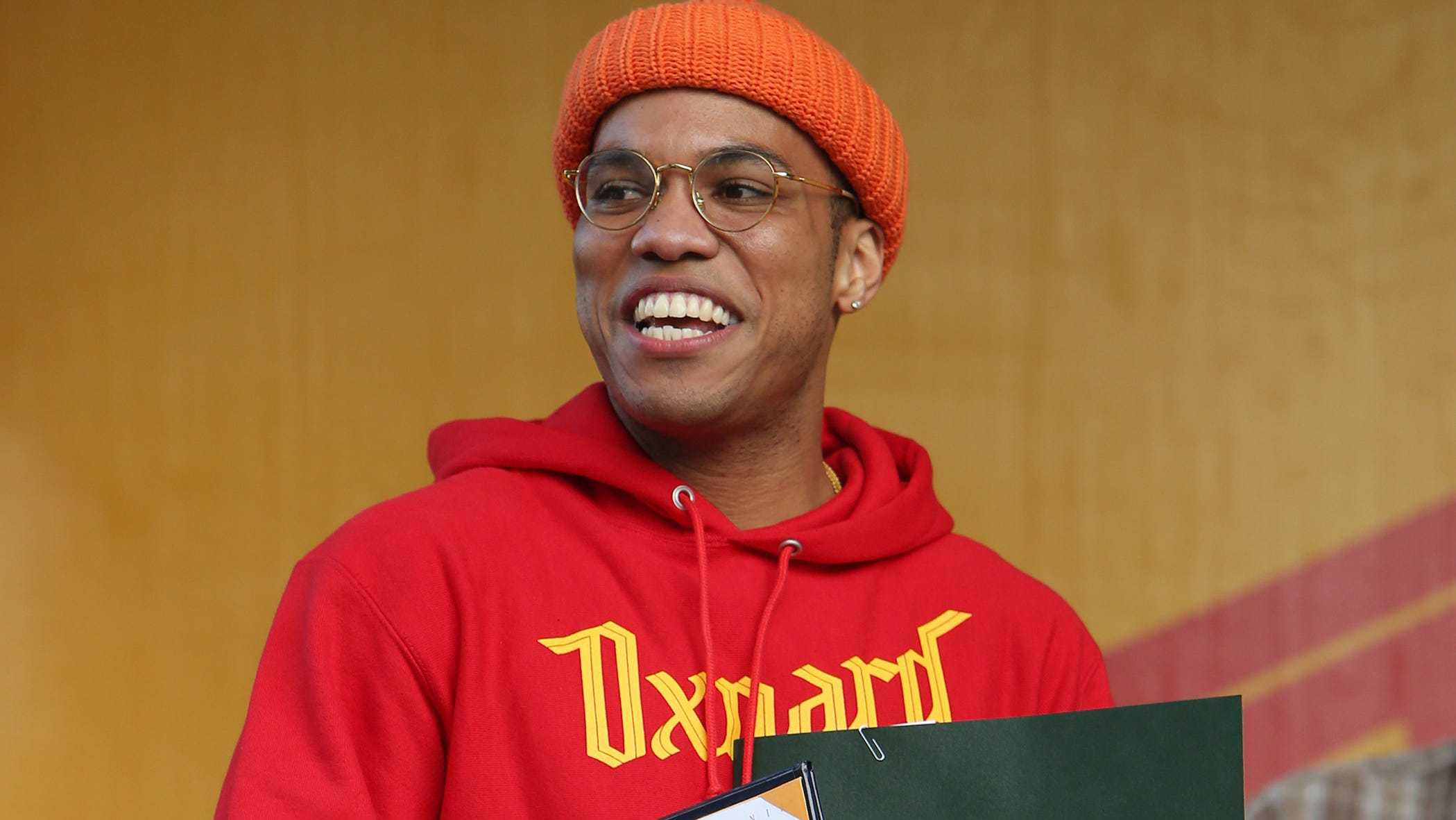 """Rapper and Oxnard native Anderson .Paak is all smiles as he holds a plaque with the keys to the city presented to him by Oxnard Mayor Tim Flynn, a certificate of recognition from state Sen. Hannah-Beth Jackson, D-Santa Barbara, and a letter of resolution from Ventura County Supervisor John Zaragoza declaring November 17, 2018, """"Anderson .Paak Day."""""""