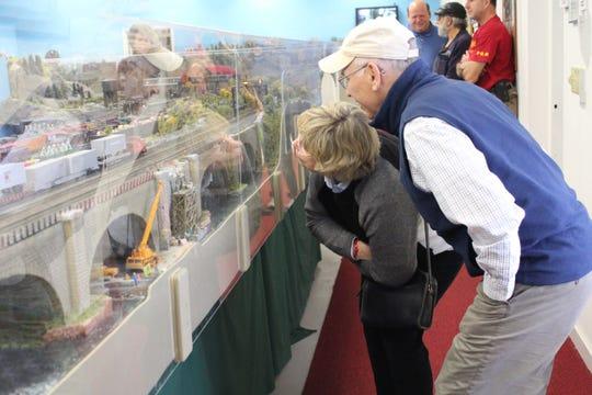 David and Barbara Salay lean down for a closer look at Patcong on Saturday morning.