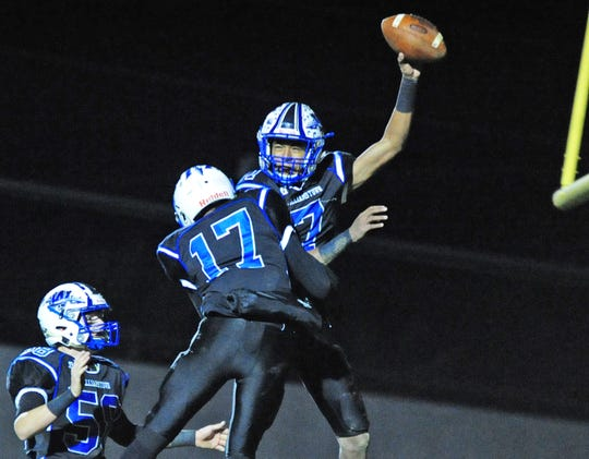 Williamstown's J.C. Collins, top, and teammates Jacob Mitten, left, and Jaire Highsmith Jr. celebrate Collins' touchdown against Rancocas Valley during Saturday night's game on November 17, 2018. Photo/Charles J. Olson