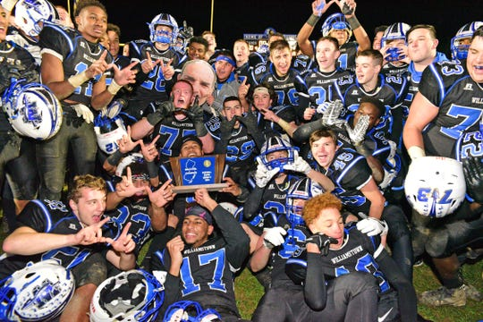 Williamstown celebrates their South Jersey Group 5 sectional title championship after defeating Rancocas Valley on Saturday.