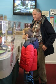 David Kishta and his grandson, Noah Soro, 9, watch one of Patcong Valley Model Railroad Club's many trains weave its way through elaborate tracks on Saturday morning.