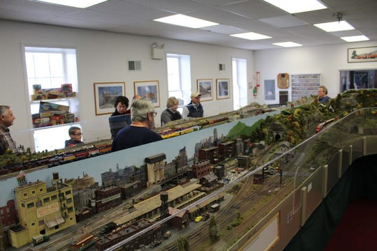Visitors and members walk around the intricate models of Patcong Valley Model Railroad Club on Saturday morning.