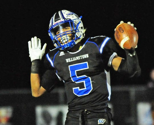 Williamstown's Wade Inge celebrates his touchdown against Rancocas Valley during Saturday night's game on November 17, 2018. Photo/Charles J. Olson