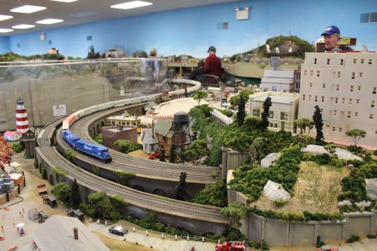 A model train makes it way through one of the many minature towns that make up Patcong's scenery.