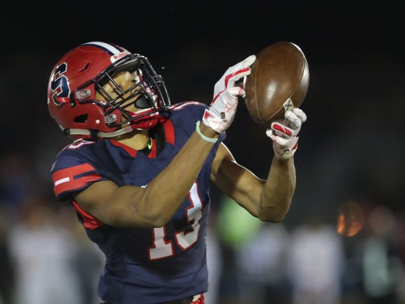 Stepinac's Eugene Boyd (13) pulls in a pass during their 29-18 win over Cardinal Hayes in the CHSFL Class 'AA' Championship Game at Mitchel Field Complex in Uniondale on Saturday, November 17, 2018.