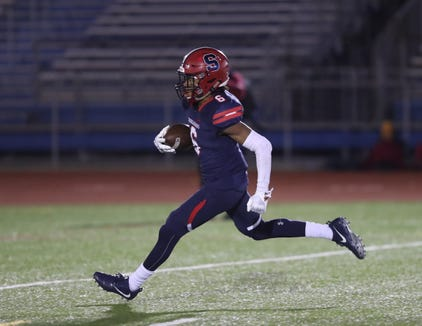 Stepinac's Shawn Harris (6) scores a touchdown during their 29-18 win over Cardinal Hayes in the CHSFL Class 'AA' Championship Game at Mitchel Field Complex in Uniondale on Saturday, November 17, 2018.
