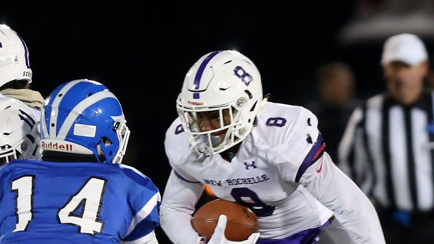 New Rochelle's Jordan Forrest (8) looks for some running room in the Shaker defense during the state Class AA semifinal game at Middletown High School Nov. 17, 2018.