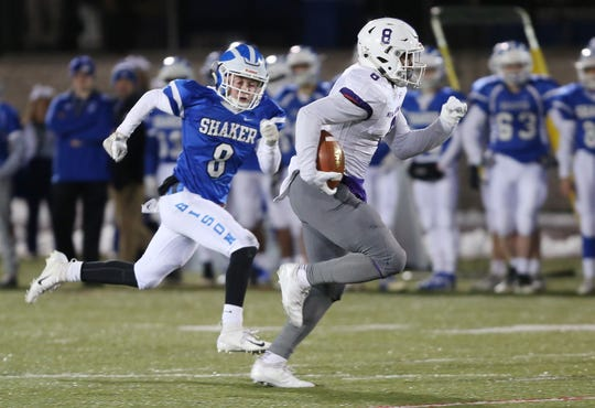New Rochelle's Jordan Forrest (8) for a big first half touchdown against Shaker during the state Class AA semifinal game at Middletown High School Nov. 17, 2018.