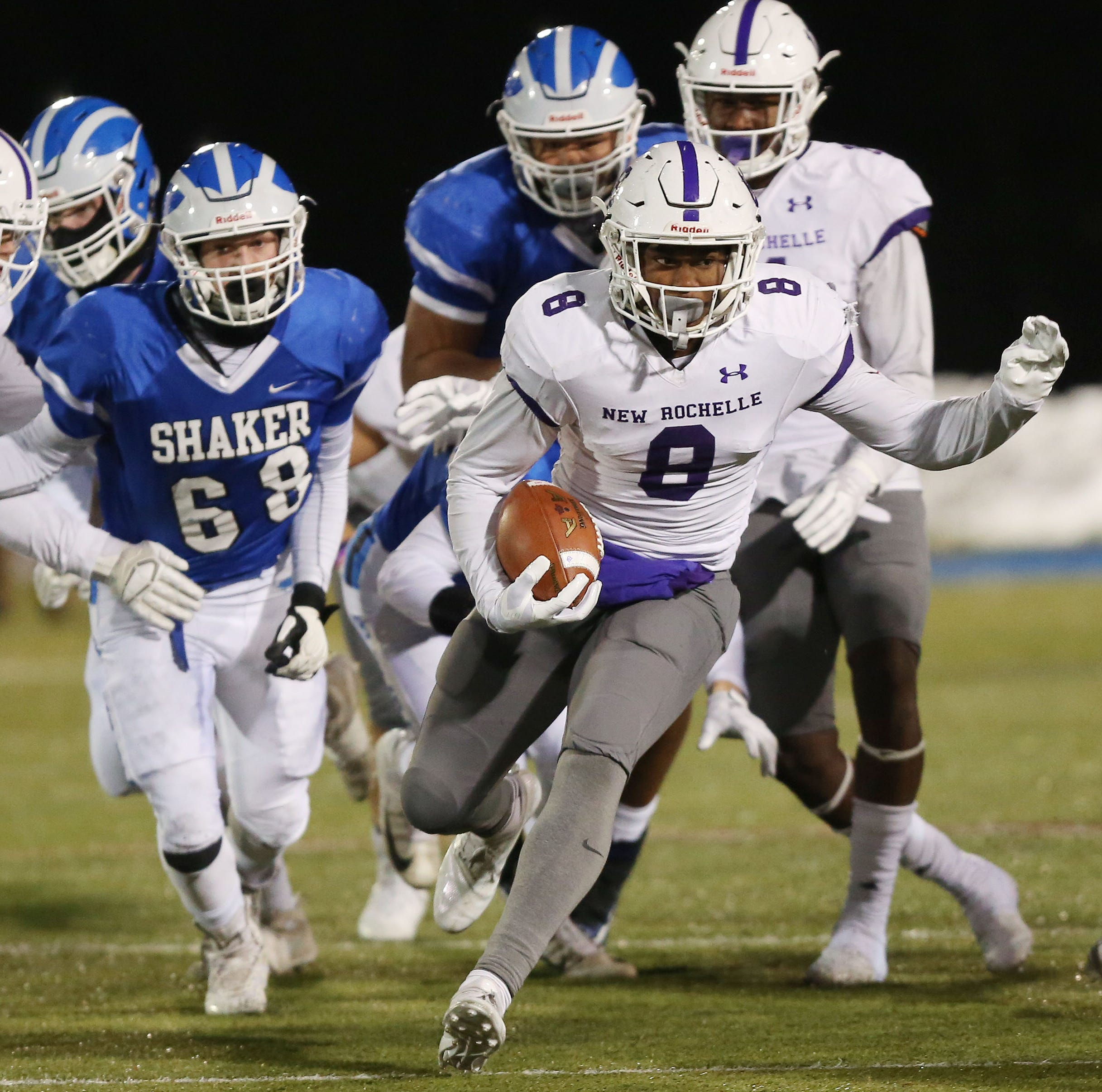 New Rochelle's Jordan Forrest (8) runs from the...